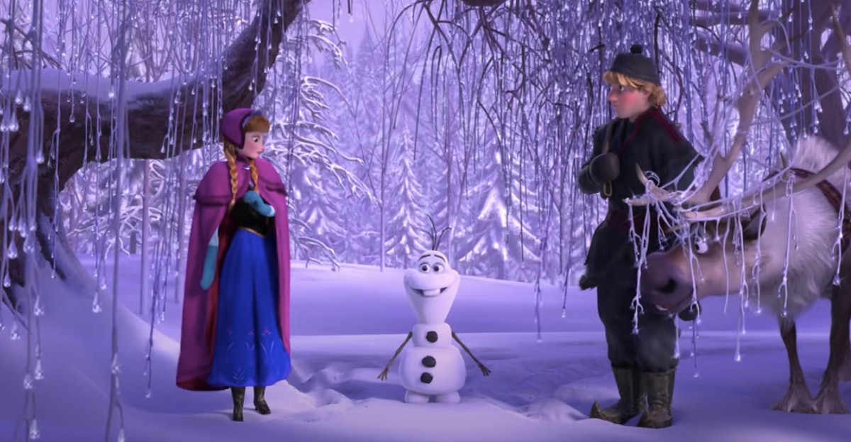 Anna, Olaf, and Kristoff from 'Frozen' stand in the snow.