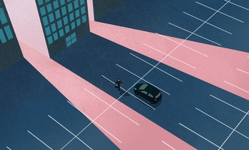 Man walking towards car alone in parking lot