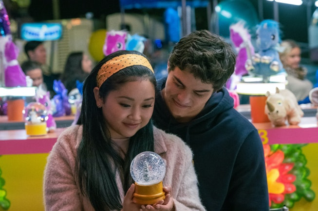 A still from Netflix's To All the Boys I've Loved Before, featuring Lana Condor as Lara Jean Covey, Noah Centineo as Peter Kavinsky at the mall.
