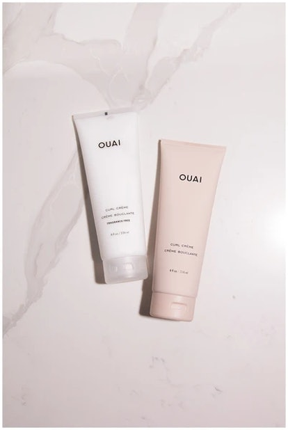Two bottles of Ouai's curl creme in scented and non-scented.