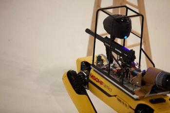 Close-up of a paintball gun mounted on a Spot robot