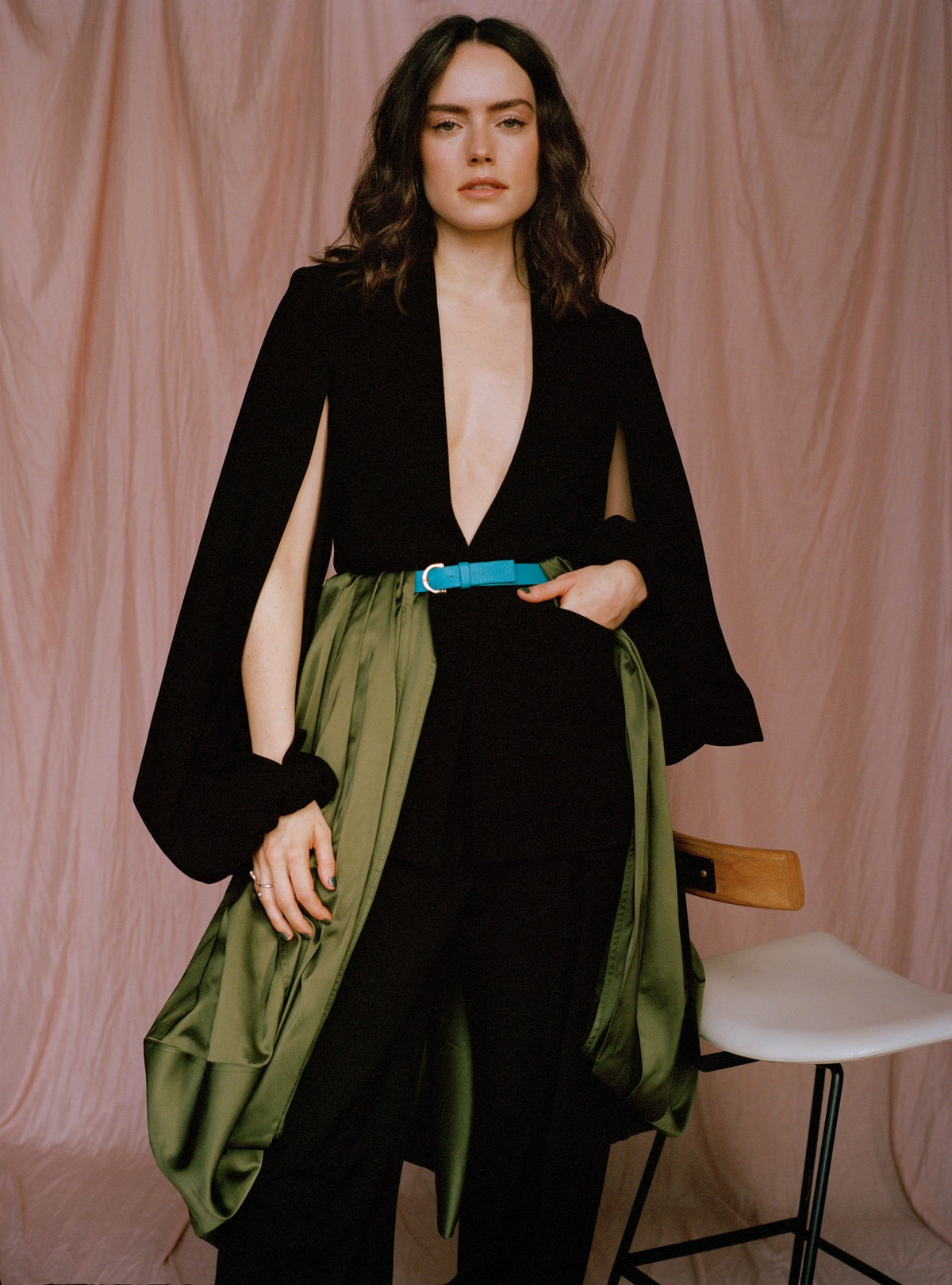 TZR cover star Daisy Ridley wears a black JW Anderson outfit with a colorful belt.