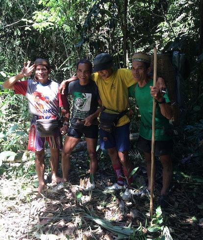 Dayak men acting as hiking trail guides.