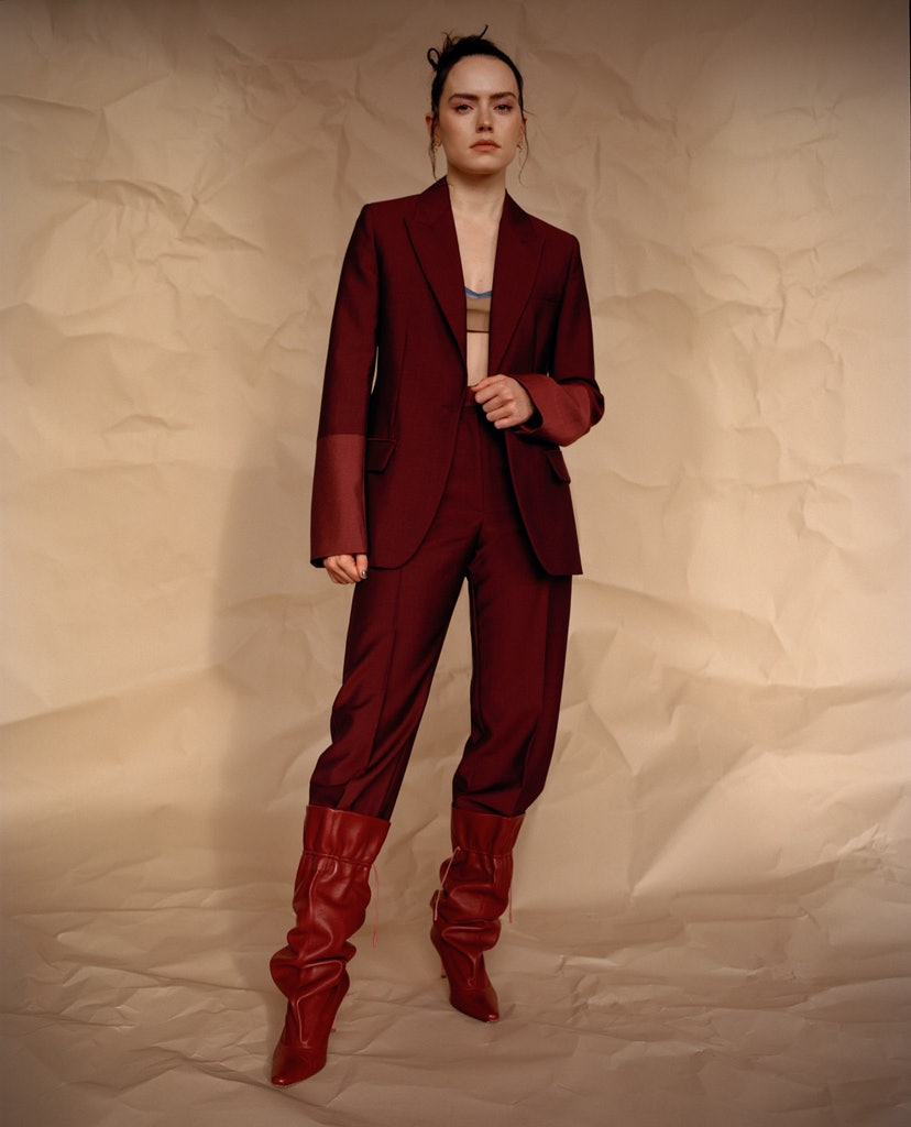 Daisy Ridley in Roksanda jacket, pants, and boots, Emilia Wickstead bralette, Araks bra (worn under), Loveness Lee earrings for TZR's Spring 2021 cover story.