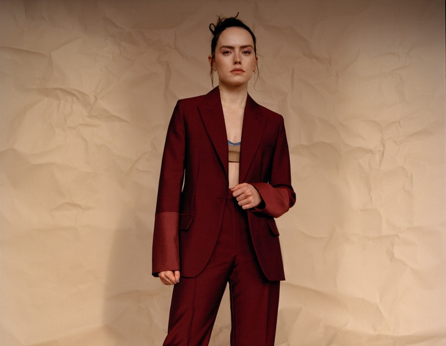 Daisy Ridley in Roksanda jacket, pants, and boots, Emilia Wickstead bralette, Araks bra (worn under), Loveness Lee earrings for TZR's Spring 2021 cover story.
