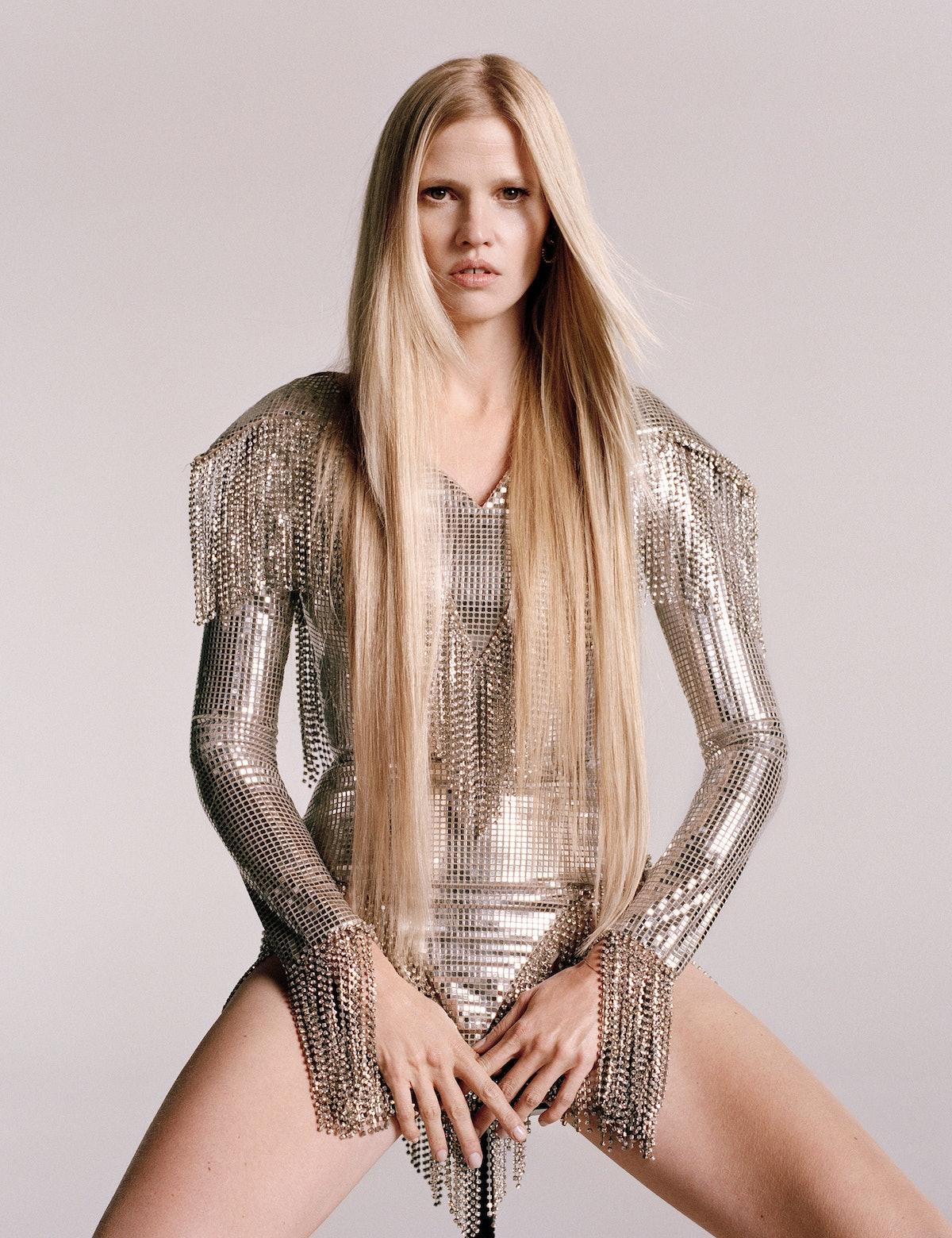 Lara Stone wears Burberry body suit; Clash de Cartier earring.