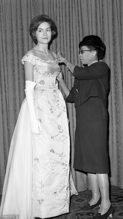 Ann Lowe adjusting a gown designed for Alice Baker.