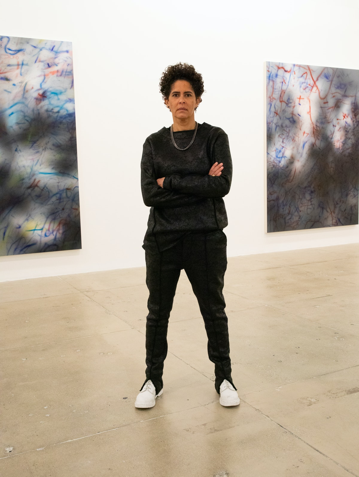 """Julie Mehretu photographed at Marian Goodman Gallery in front of (from left) """"About the Space of Hal..."""
