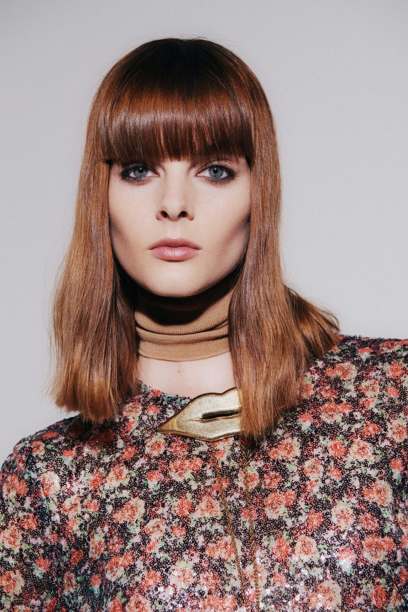 Red hair model with bangs from the Fall Winter 2021 Victoria Beckham show