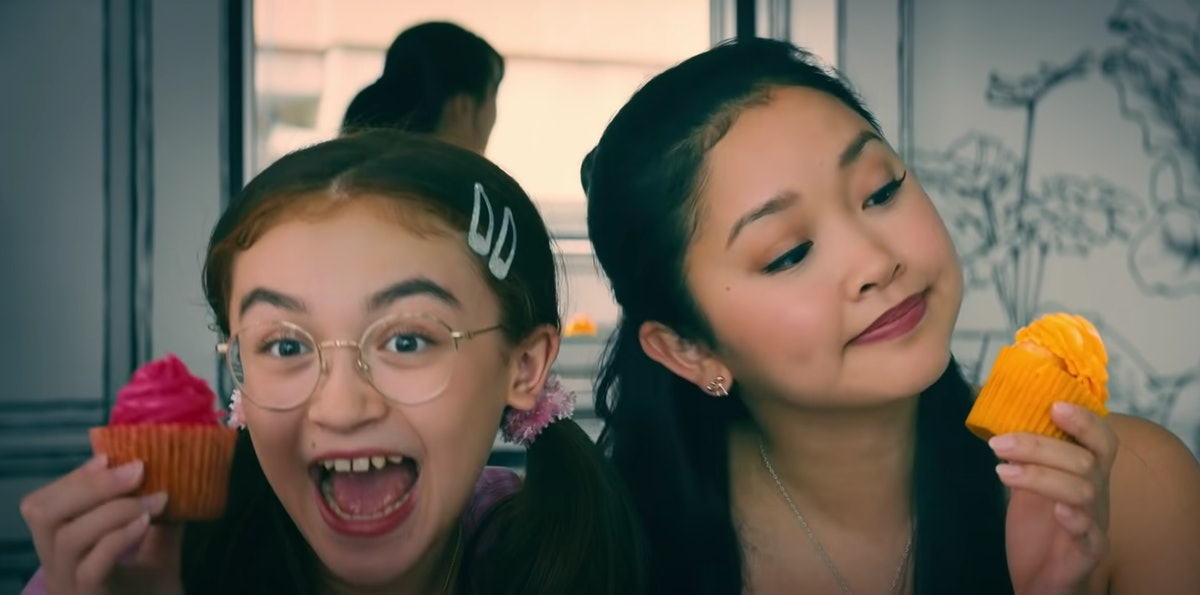 Lara Jean and her sister pose with cupcakes at a 2D cafe in Korea in 'To All The Boys: Always and Fo...