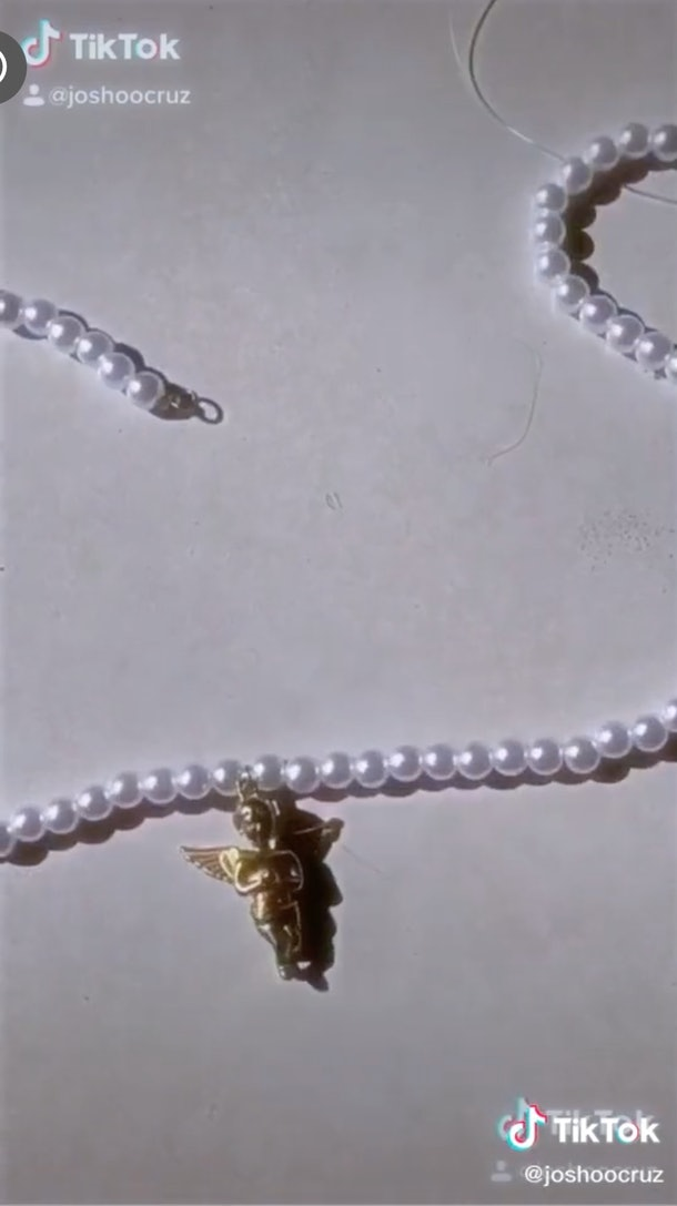 TikToker @joshoocruz makes an opulent pearl necklace by adding a baby angel charm.