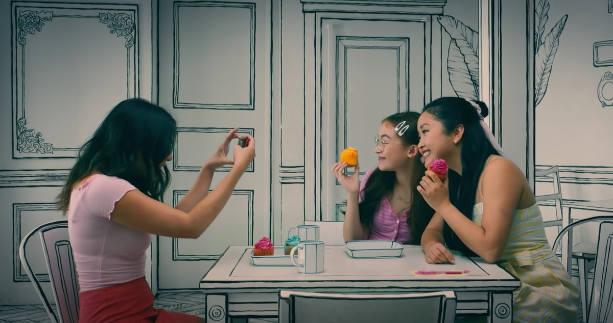 Lara Jean and her sisters pose for a picture at a 2D cafe in Korea in 'To All the Boys: Always and F...