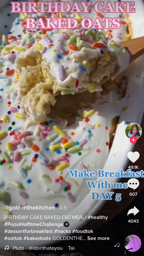 A woman spoons out some birthday cake baked oats.