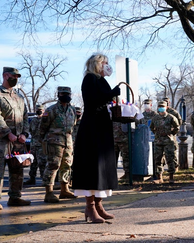 US First Lady Jill Biden surprises National Guard members outside the Capitol with chocolate chip cookies on January 22, 2021, in Washington, DC.