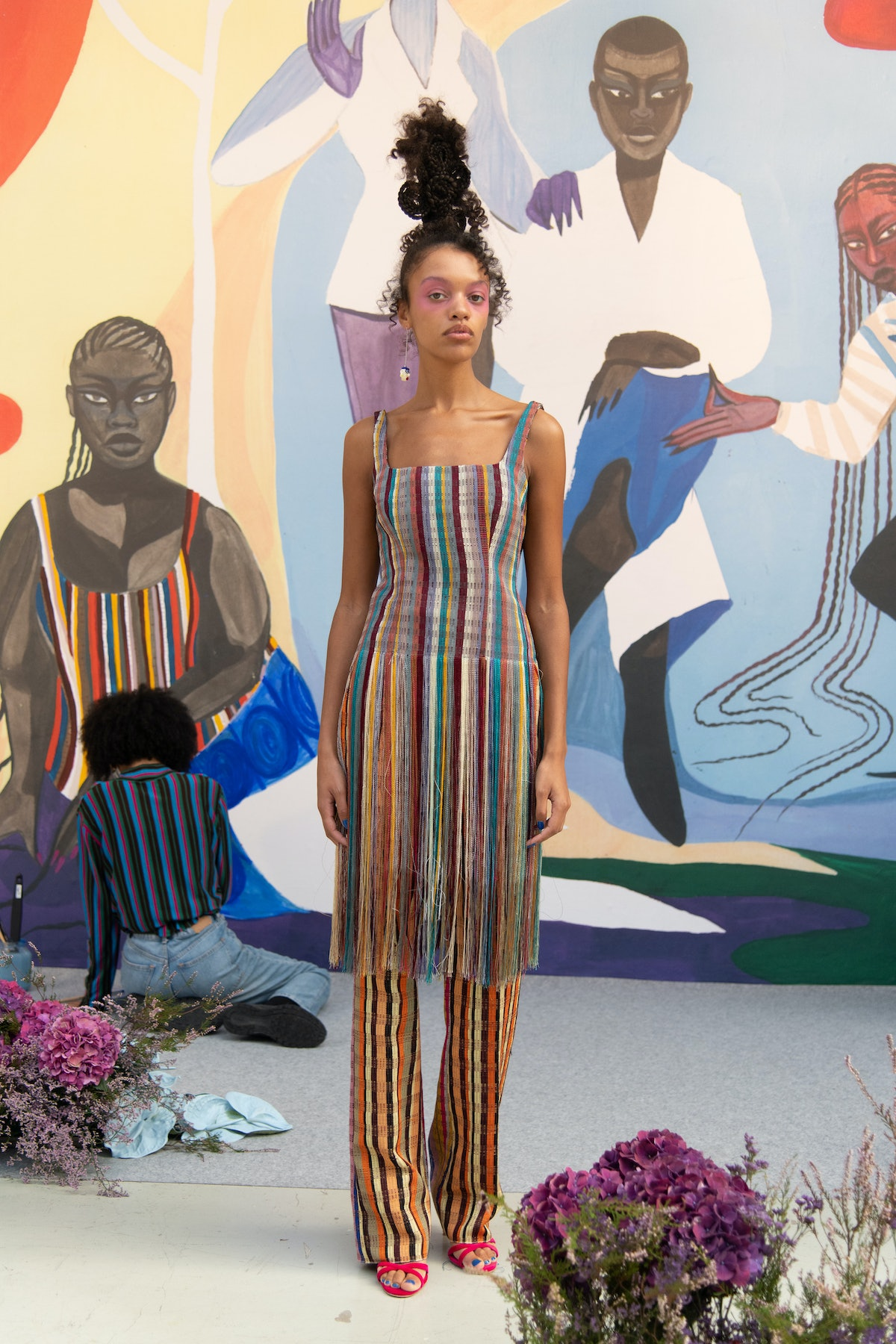 model wearing striped dress and pants