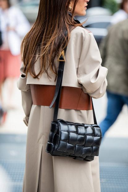 Chloe Harrouche seen wearing beige brown two tone coat, black Bottega Veneta cross body bag and shoes LIDO -PS20 outside the Sportmax show during Milan Fashion Week Spring/Summer 2020 on September 20, 2019 in Milan, Italy.