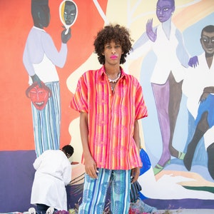 model wearing pink striped top and blue striped pants