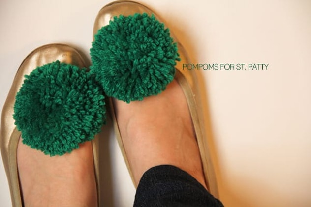 green pom poms on shoes