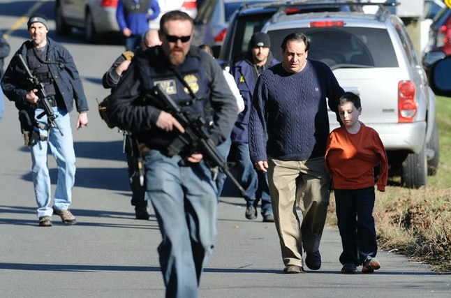 A parent is reunited with a child in Newtown, Connecticut, after the 2012 school shooting at Sandy Hook Elementary School.
