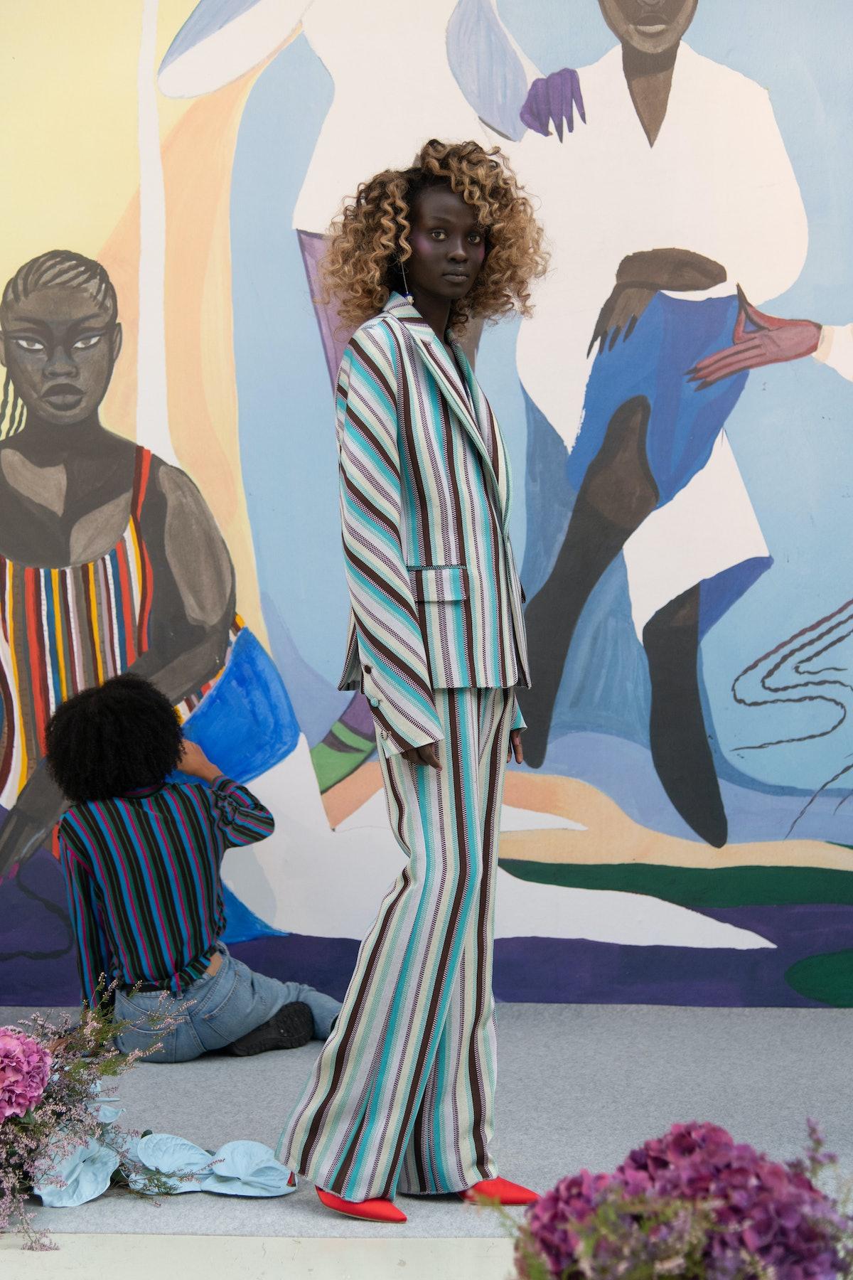 model wearing blue striped suit