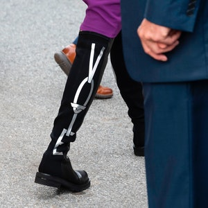 """Jill Biden wears boots that read """"vote"""" as she departs the state building after voting in the Delaware state primary in Wilmington, Delaware on September 14, 2020."""