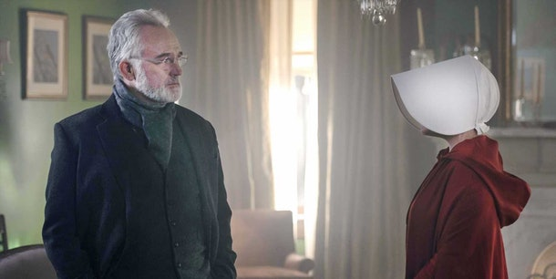 Elisabeth Moss as June and Bradley Whitford as Commander Joseph Lawrence in The Handmaid's Tale