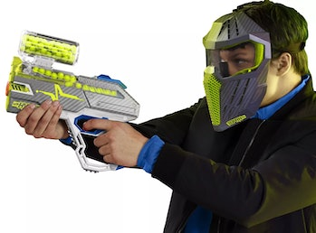 Kid holding a Nerf Hyper blaster and wearing a mask.