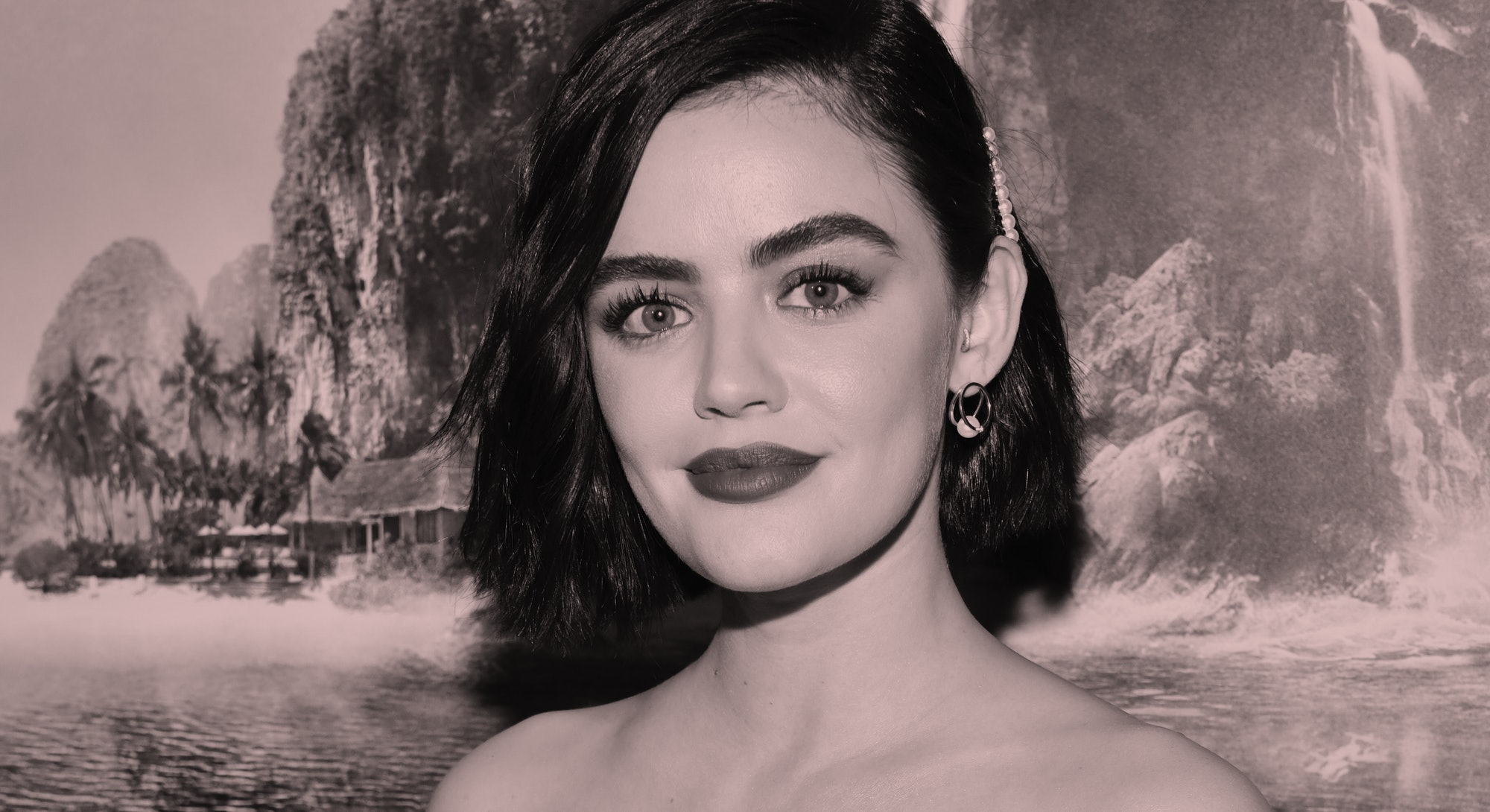 Lucy Hale, wearing pink lipstick, stands against backdrop of fake waterfall