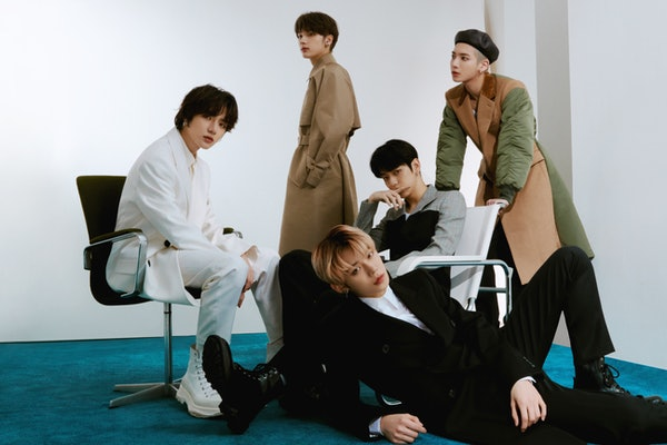 K-pop band TOMORROW X TOGETHER pose for the cover of Elite Daily.