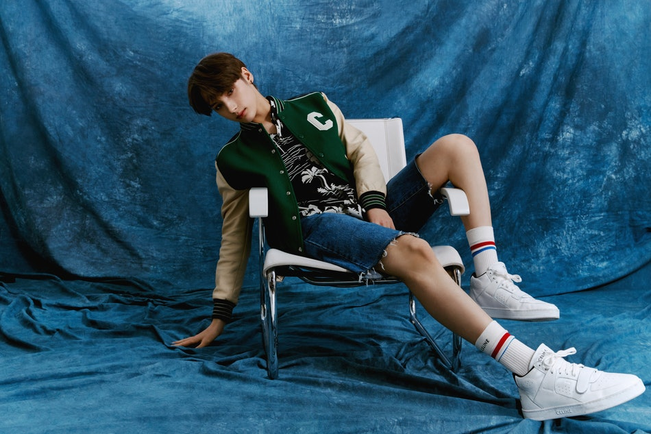 Hueningkai wears Celine by Hedi Slimane jacket, shirt, socks, and shoes, stylist's own shorts and earring