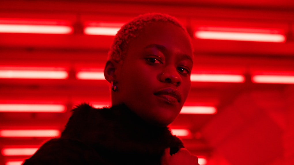 Portrait of young woman in neon light