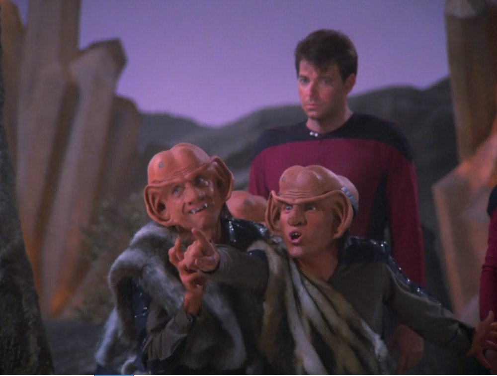 Two Ferengi standing in front of an annoyed First Officer Riker on an episode of Star Trek:  The Next Generation