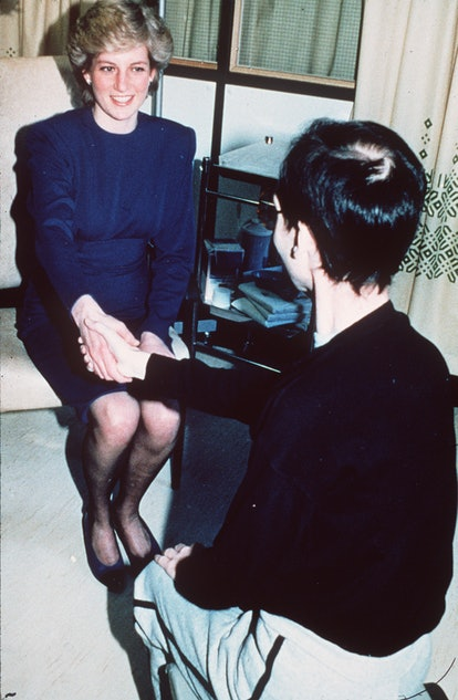 Diana, Princess of Wales shakes hands with a man with AIDS in 1987