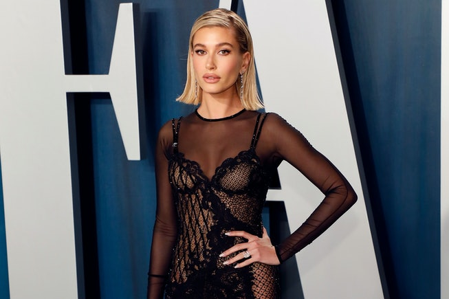 Hailey Bieber, who is possibly working on a beauty brand, poses on a red carpet