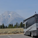 RV parked in front of the mountains