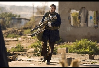 Sharlto Copley looking up in danger during District 9