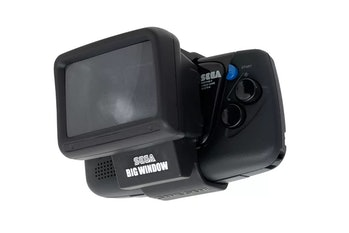 Sega's Game Gear Micro retro handheld with a Big Window magnifying attachment.