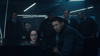 Agent James Woo (Randall Park) with S.W.O.R.D.