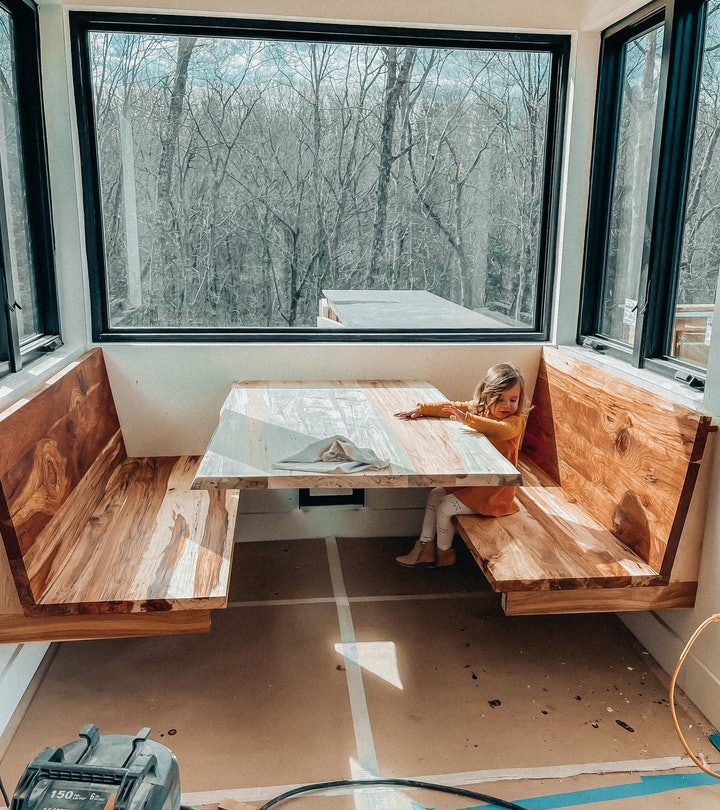 One family decided to build a restaurant booth in their kitchen.
