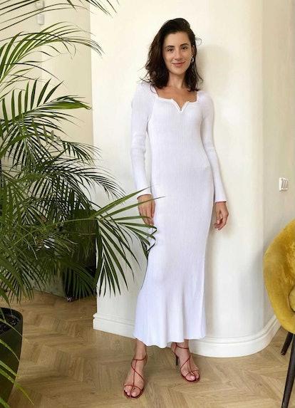 Svitlana Bevza in a white dress.