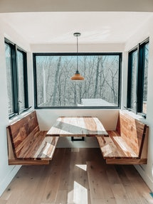 A family built a restaurant booth in their kitchen.