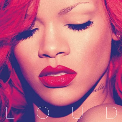 The album cover for Rihanna's 'Loud'. It shows a close-up of Rihanna's face. Her eyes are closed, her red hair framing her face, and she's wearing red lipstick.
