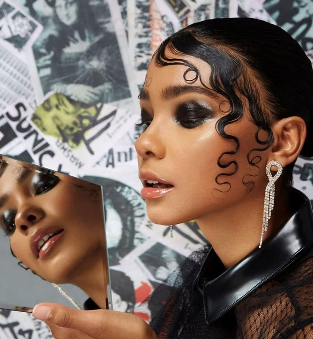 Got2be model with dark eye makeup and artful edges.
