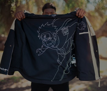 Vader holding black and white parka with Naruto graphic