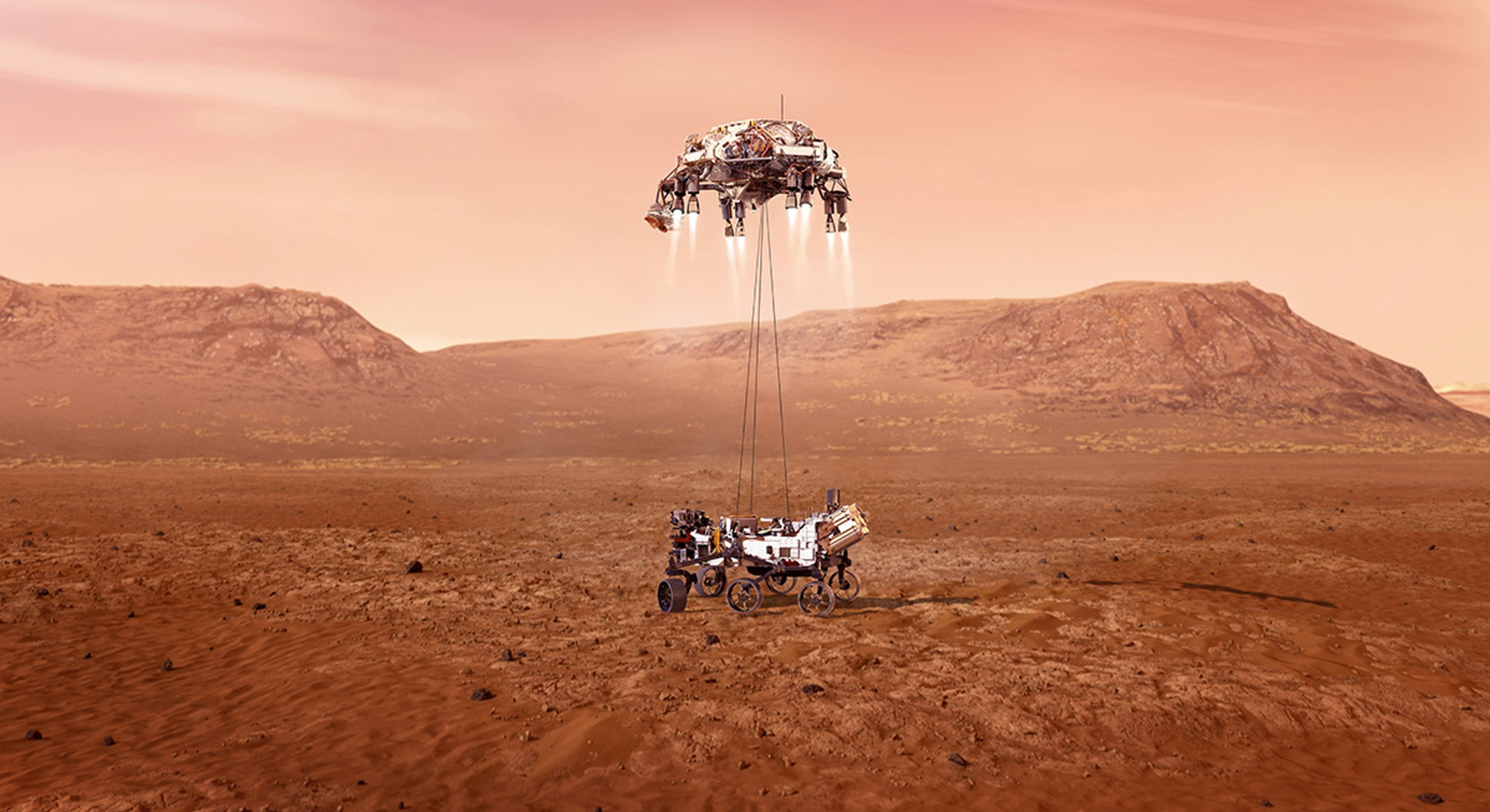 The Perseverance rover being lowered onto the Martian surface using wire cables.