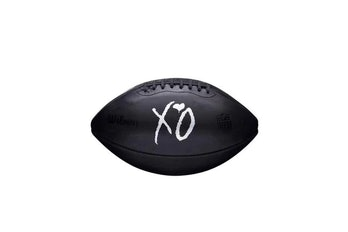 Black football with XO in the middle