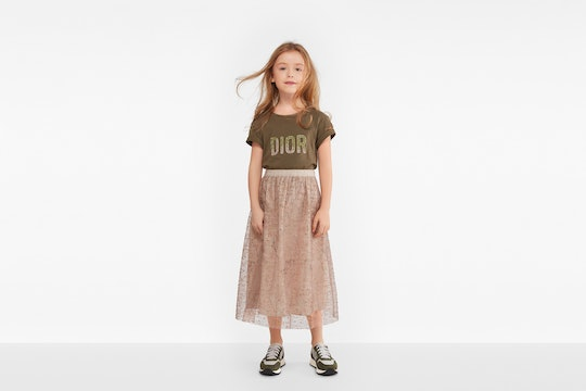 little girl in dior outfit