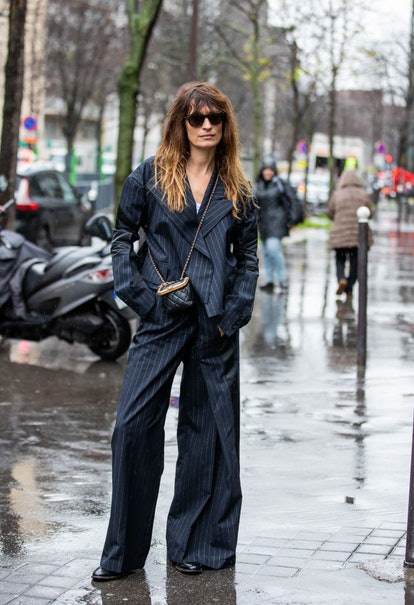 Caroline de Maigret streetstyle photo wearing wide-leg pants
