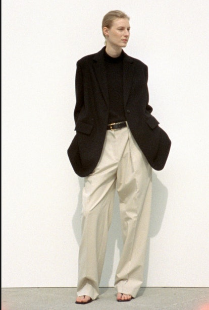 model wearing wide leg chino pants and black blazer