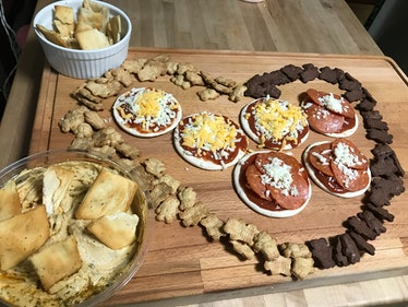 Hummus, Teddy Grahams, pita chips, and Lunchables as cheese board
